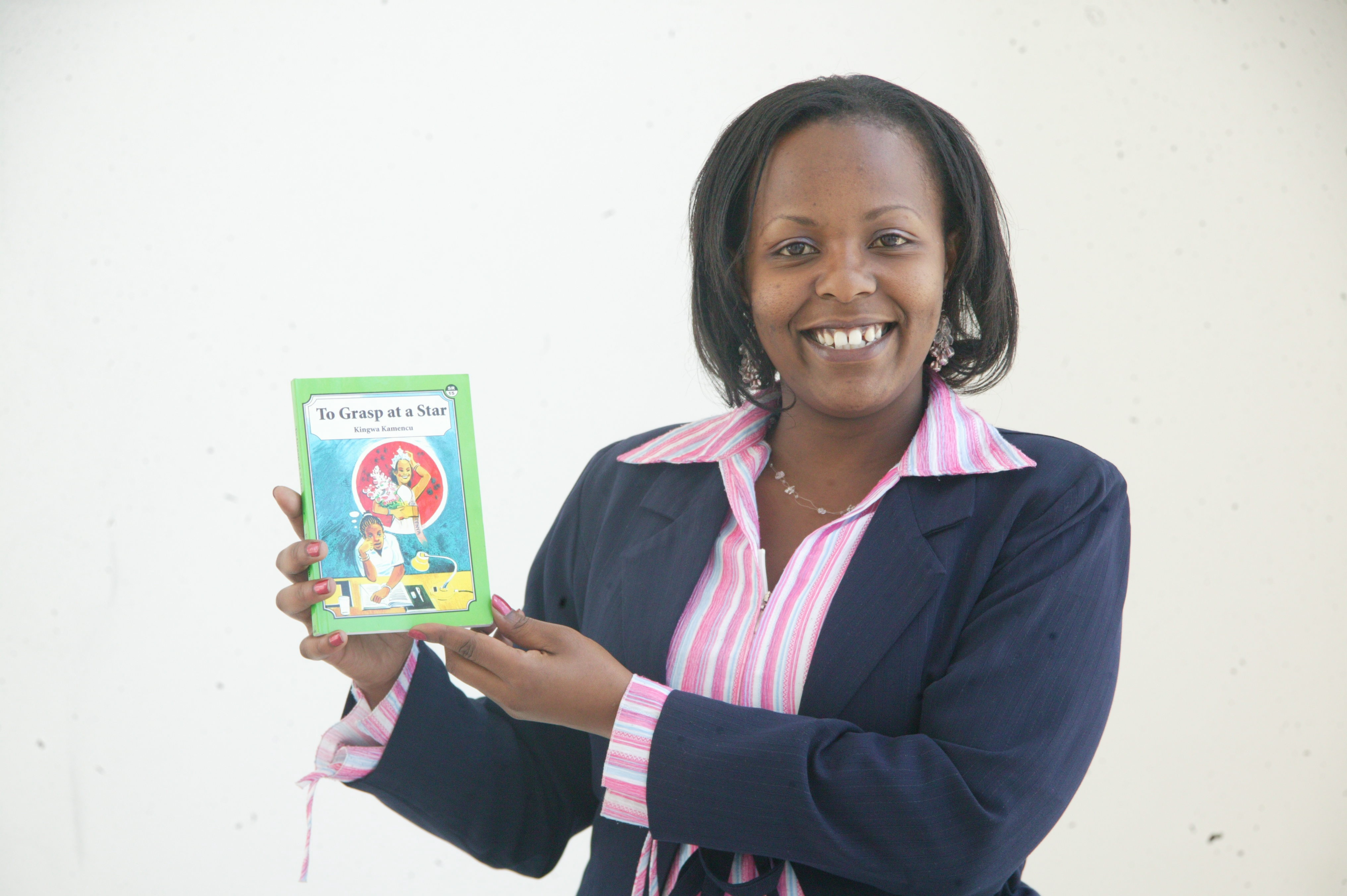 The author holds a copy of her book